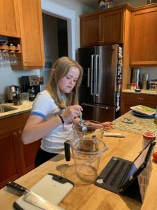 Windermom, Kate Hauter cooking with daughter during covid 19, Windermoms Quarantine Activities